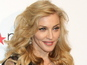 Madonna tracks handed to Chris Brown