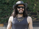 Russell Brand wearing ripped jeans and boots and a straw stetson hat, out and about in West Hollywood. Los Angeles, California