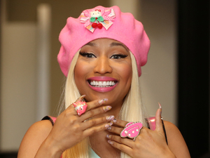 Nicki Minaj signs copies of her new album 'Pink Friday: Roman Reloaded' at HMV