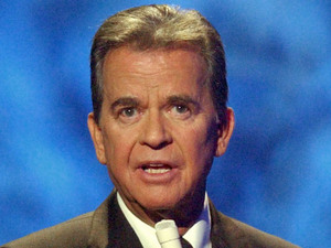 Dick Clark on the American Bandstand television show as he introduces Michael Jackson on stage for the show&#39;s 50th anniversary special