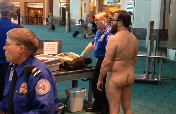 John E. Brennan stands naked after he stripped down while going through a security screening area