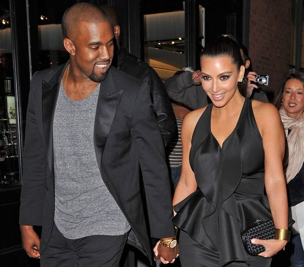 Kim Kardashian and Kanye West hold hands on night out.
