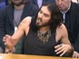 Russell Brand cracks jokes at MPs