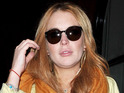 Lohan is determined to continue filming Elizabeth Taylor biopic.