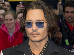 Johnny Depp arrives for the European Premiere of Dark Shadows, at a central London cinema