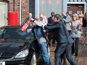 Everyone looks on as David smashes Nick's car up