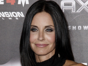 "Friends Cast Then and Now - Courteney Cox arrives at the premiere of ""Scream 4"" in Los Angeles, 2011"