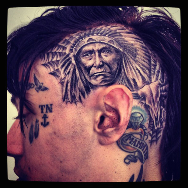 Trace Cyrus posted this image on Twitter with the caption ''Got my head tatted today! Excuse all the ink on my face. And yes this hurt!!!'