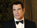 A writer claiming that Travolta engaged in gay sex acts accuses the actor of discrediting him.