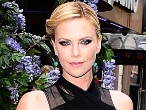 Charlize Theron arriving for the UK premiere of Snow White And The Huntsman at the Empire and Odeon Cinemas in Leicester Square, London