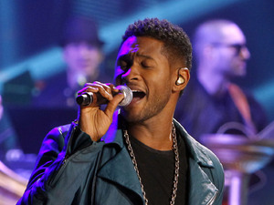 Usher performing at a Romeo Santos concert at Madison Square Gardens, February 2012