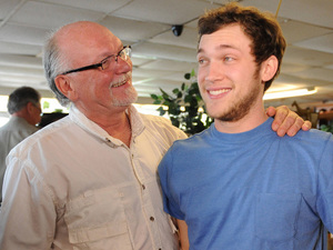 Phillip Phillips and his father Don Phiilips at his families business, Albany Sporting Goods and Pawn during his hometown visit to Leesburg, Georgia