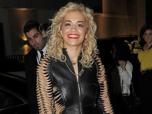 Rita Ora arrives at Whiskey Mist. Rumored boyfriend Rob Kardashian arrived in a separate car possibly to avoid being photographed with Ora.