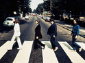 A photo of The Beatles walking the opposite way at Abbey Road is up for auction.