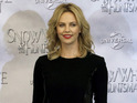 Charlize Theron jokes that she 'stalked' Agent 13 director Rupert Wyatt.