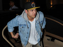 Reality star accused of lashing out at paparazzo taking pictures of him.
