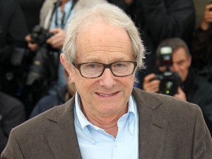 Director Ken Loach poses during a photo call for The Angel's Share at the 65th International Cannes Film Festival