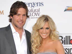 Mike Fisher and Carrie Underwood arriving at the 2012 Billboard Awards at the MGM Grand, Las Vegas