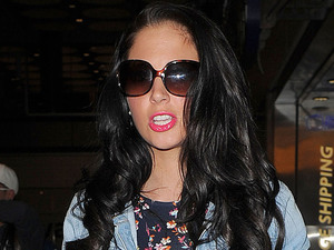 Tulisa Contostavlos is seen arriving at Heathrow Airport, London after a late night flight from Glascow