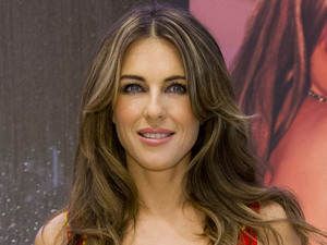 Liz Hurley pictured in House of Fraser, in the Westfield Shopping Centre in west London, to promote her new home collection for the store