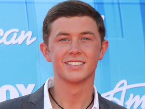 Winner of last years competition Scotty McCreery attended the American Idol Season 11 grand finale show, held at the Nokia Theatre in Los Angeles