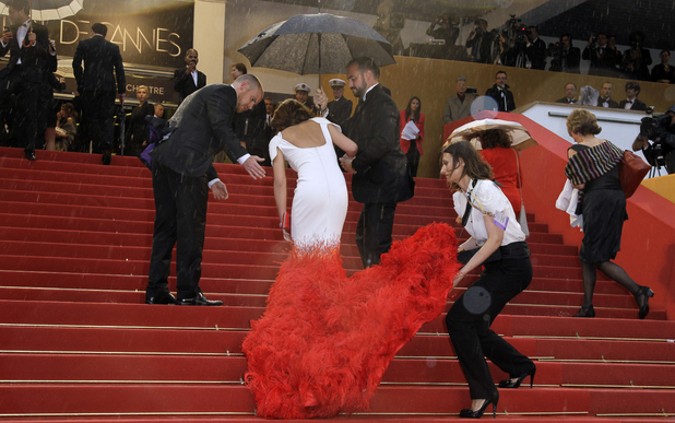 Cheryl Cole is helped up the stairs