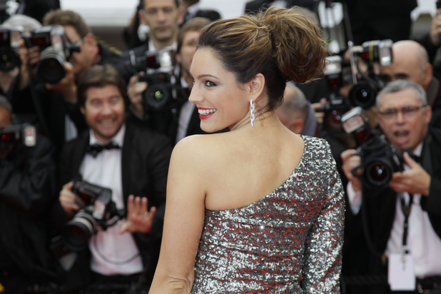 Kelly Brook poses for photographers as she arrives for the screening of 'You Ain't Seen Nothing Yet' at the 65th International Cannes Film Festival