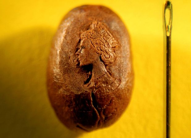 Queen portrait on coffee bean