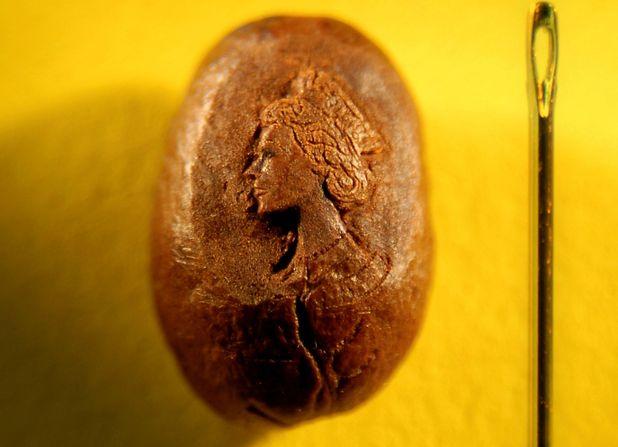 Queen portrait on coffee bean