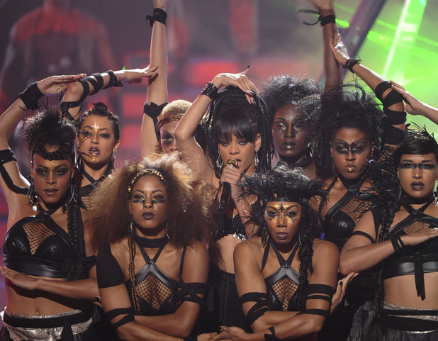 Rihanna flanked by dancers during her performance