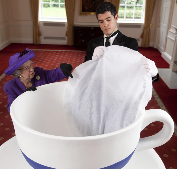 Queen Elizabeth look-alike, Elizabeth Richard, poses with a giant tea bag to launch Tetley Tea&#39;s limited edition 60 person street party tea bag