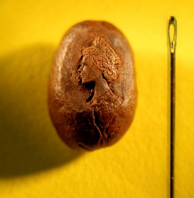 A portrait of the Queen on a coffee bean