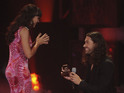 Ace Young gets down on bended knee on stage at the American Idol finale.