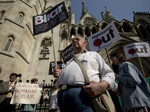 Anti-war protesters demonstrate outside the Royal Courts of Justice on the day former British Prime Minister Tony Blair was appearing at the Leveson media ethics inquiry in London
