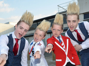 Jedward arrive back in Dublin Airport after performing at the Eurovision 2012 song contest. They are seen posing here with freakishly accurate lookalike fans - brothers Nathan & Cian Delaney