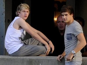 Niall Horan and Liam Payne relaxing backstage at the Molson Amphitheatre in Toronto ahead of the One Direction concert