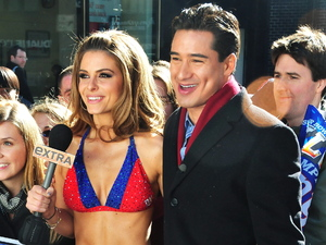 Maria Menounos wears a New York Giants bikini to film a segment for 'Extra' in Manhattan with Mario Lopez New York City, USA
