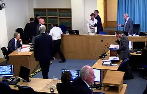 A protestor burts into the room during Tony Blair's evidence during the Leveson Inquiry