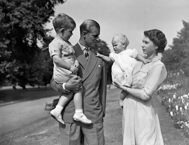 Princess Anne in the arms of Princess Elizabeth, with the Duke of Edinburgh, holding Prince Charles