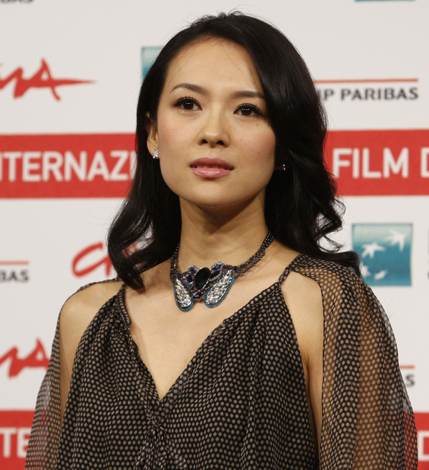 Chinese director Gu Changwei and actress Zhang Ziyi pose during a photo call for the movie 'Love for Life' at the Rome International Film Festival in Rome, Wednesday, Nov. 2, 2011. (AP Photo/Domenico Stinellis)