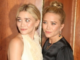 The Olsen twins Mary-Kate and Ashley pose for photographs at The Fresh Air Funs Salute To American Heroes in New York