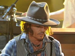 Johnny Depp plays guitar at the MTV Movie Awards 2012