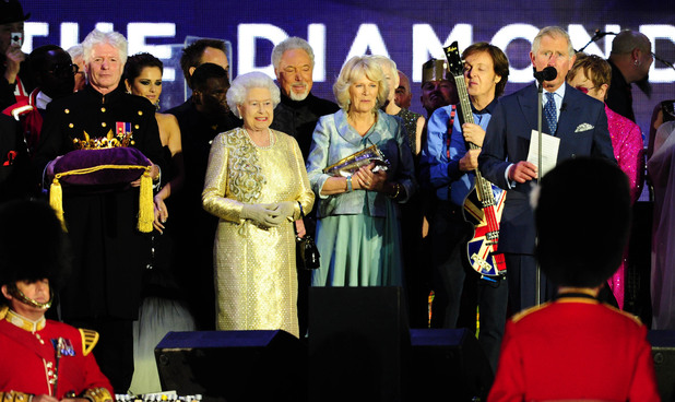 Queen Elizabeth II, Prince Charles and the Duchess of Cornwall on stage outside Buckingham Palace during the Diamond Jubilee Concert.
