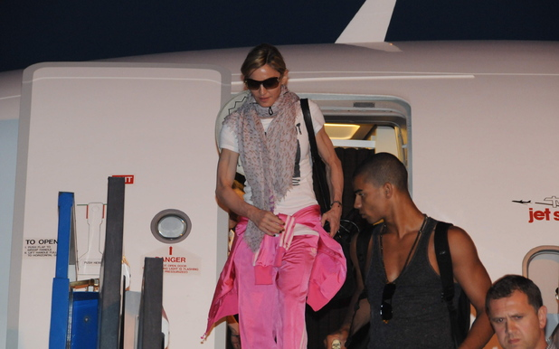 Madonna and Brahim Zaibat Madonna arrived in Istanbul last night with a crowded entourage and heavy equipment. She is set to perform a concert on Thursday, June 7th at Istanbul's Turk Telecom Arena.  Three airplanes carried the pop icon and her 200 person entourage, including her children and their nanny. A red carpet was spread out for the superstar and she was immediately surrounded by heavy security. Istanbul, Turkey
