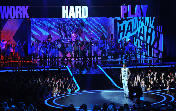 Wiz Khalifa takes to the MTV Movie Awards stage - with a lot of dancers in tow