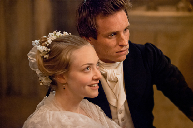 Amanda Seyfried as Cosette and Eddie Redmayne as Marius