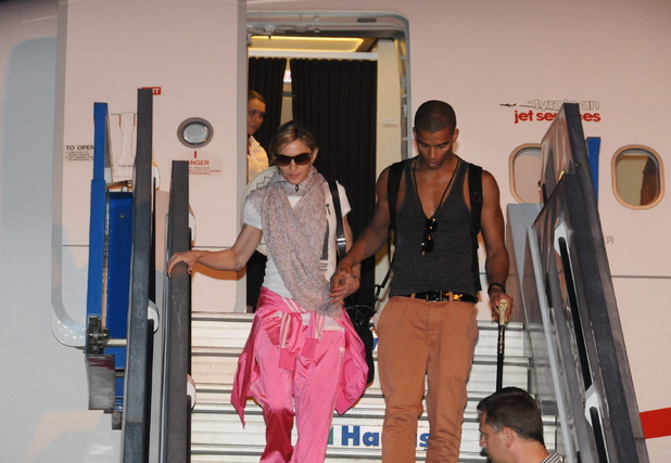 Madonna, Brahim Zaibat Madonna arrived in Istanbul last night with a crowded entourage and heavy equipment. She is set to perform a concert on Thursday, June 7th at Istanbul's Turk Telecom Arena.  Three airplanes carried the pop icon and her 200 person entourage, including her children and their nanny. A red carpet was spread out for the superstar and she was immediately surrounded by heavy security.