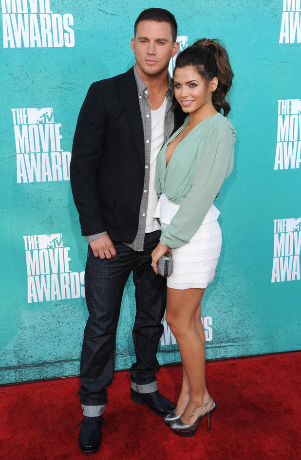 Channing Tatum and Jenna Dewan Tatum on the red carpet at the MTV Movie Awards 2012