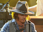 Depp plays guitar at MTV Movie Awards