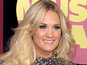 Carrie Underwood gives fan his first kiss